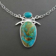 ~ Peruvian opal and chrysocolla pendant necklace in sterling silver ~ Dreamy streams of blue meander across the surface of this Peruvian opal, with the brown host rock / boulder adding a gorgeous blend of tones. Above it sits a magnificently colored chrysocolla, adding even more