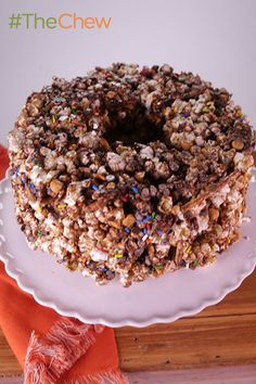 Make this better version of crispy rice treats for your next kid's birthday party! This Popcorn Party Cake is so easy to make with just popped popcorn, pretzel sticks, mini chocolate chips, butterscotch chips, mini marshmallows and rainbow sprinkles!