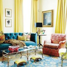 Chic living room with yellow curtains framing blue velvet tufted