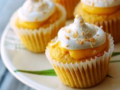 Lemon-Filled Coconut Cupcakes with Meringue Frosting