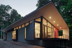 A couple builds a home that makes the most of its woodsy site.