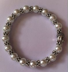 White glass pearls with daisy spacers and Buddha bracelet