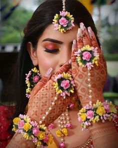 Buy this beautiful multicolor bridal floral flower jewellery set with mangtika, earrings, and bracelet for women and girls. and use this beautiful jewellery in your Haldi Ceremony, Baby Shower, and Dohale Jevan. Mehendi Photography, Indian Wedding Photography Poses, Photography Ideas, Couple Photography Poses, Fashion Photography, Bridal Mehndi Dresses, Indian Bridal Outfits, Indian Bridal Photos, Indian Bridal Fashion