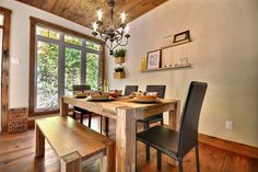 What a cozy cottage rustic dining room! My favorite parts are the mixed seating options and the gorgeous wooden table.