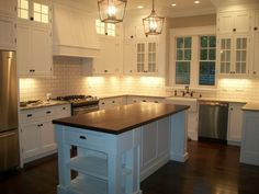 love the layout and how they have the cabinets arranged-glass/wood