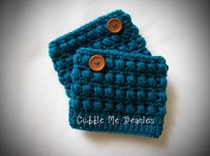 Puff Boot Cuff Crochet Pattern pattern on Craftsy.com. I like the button. I should try these with a raspberry stitch.