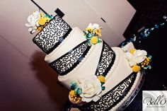 Fun and whimsical wedding cake with the popular yellow and teal wedding colors! Love the angles. #weddingcake #belloromancephotography