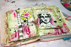 Donna Downey's lovely green and magenta art journal layout; you can see the full process and materials list here ~ http://donnadowney.typepad.com/simply_me/2013/07/inspiration.html ~ using gesso, glazing fluid, matte medium and joint compound to add a little texture (and why not!) plus Pam Carricker face stamp.