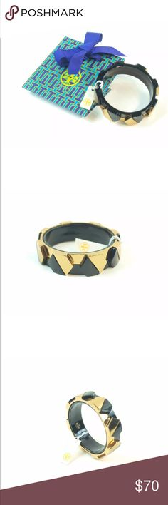 "TORY BURCH 'CONNOR' Wide Hexagonal Bangle NWT TORY BURCH 'CONNOR' Wide Hexagonal Bangle Black and Gold  The Connor Wide Hexagonal Bangle, with its geometric and color-blocked design this chunky, lightweight style packs some graphic punch. Wear alone or stacked with a wristful of other bracelets  Color blocked hexagonal bangle bracelet.  Signature logo studs on interior.  Slips on.  Diameter: 2.6"" Width: .8""  Resin/Gold-plated metal.  Imported  Including the gift bag, Retails for $135 Tory…"