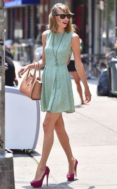 Taylor Swift looked perfectly put together (as usual) in a mint green polka dot mini dress, fuchsia pumps and of course her classic wayfarers!