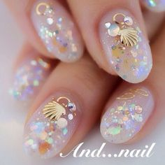 Gorgeous seashell nails, not my own. Does anyone know of any opalescent and glitter polishes where I can replicate the look?