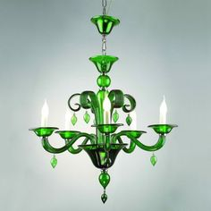 Unusually shaped fixture with curved glass arms and colored glass b...