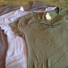 Danskin Now XL 16/18 workout shirts set of 3 Danskin Now XL 16/18 workout shirts set of 3 ...colors -drkorc; periwinkle; grystn.  All in like new condition. Cotton , spandex & model Danskin Tops Tees - Short Sleeve