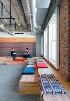 Yelp HQ Office, San Francisco, CA. Cushions covered in rayon-cotton or wool line oak bleachers in a lounge. large tech company