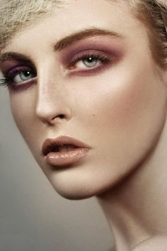 Dark pink smokey eye.