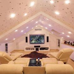 Home Theater- great way to use that awkward half level in some houses!