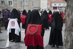 """Veiled women, also known as Les Pleureuses (""""mourning women'), whose faces are covered with black cloth to commemorate the Passion and Crucifiction of Jesus."""