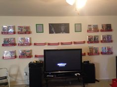The comic book display I made for my husband using IKEA spice racks and frames and red paint.