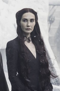 Can anyone explain to me why Melisandre's hair is suddenly so dark?? It used to be like bright red and now it's almost purple