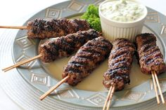 Kofta - Middle Eastern grilled meatballs served with tzatziki Beef Recipes For Dinner, Meat Recipes, Cooking Recipes, Turkey Recipes, Lebanese Recipes, Greek Recipes, Shish Kebab, Dinner With Ground Beef, Middle Eastern Recipes