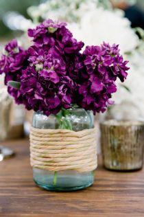 Purple flowers in mason jar
