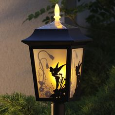 Tinkerbell Lamp.  Needed for the new house!http://www.ebay.com/bhp/disney-solar-lights- para el cuarto de adas de Emilia