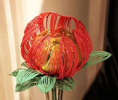 King Protea, South African national flower, beaded flower by Bia Alessi and Sérgio Zavaglia.