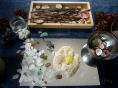 Making imprints in playdough using natural materials from An Everyday Story A Week of Playdough