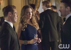 """Arrow -- """"Crucible"""" -- Image AR204a_5723b -- Pictured (L-R): Kevin Alejandro as Sebastian Blood, Katie Cassidy as Laurel Lance, and Stephen Amell as Oliver Queen -- Photo: Jack Rowand/The CW -- © 2013 The CW Network, LLC. All Rights Reserved"""