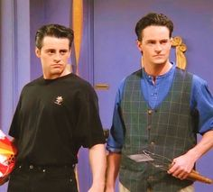 The one with the denim mandarin-neck shirt and checked vest. | Chandler Bing's 19 Most HeinousOutfits