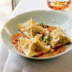 Ginger-Shrimp Pot Stickers with Spicy Peanut Dipping Sauce Recipe Appetizers with green cabbage, green onions, carrots, chopped cilantro fresh, low sodium soy sauce, peeled fresh ginger, dark sesame oil, salt, shrimp, hot sauce, wonton wrappers, corn starch, canola oil, water, water, peanut butter, low sodium soy sauce, seasoned rice wine vinegar, chile paste with garlic, sugar, green onions