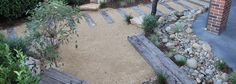 Modern Australian Native Japanese Garden – Waterfall and River/Pond. Front Garden, Entryway Path – Sandstone Boulders, River Pebbles, Recycled railway Sleepers, Crushed Granite, Westringia, Flax, Kangaroo Paw, Blue Fescue Grass
