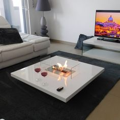 cheminée ethanol et télévision AFIRE. Cheminée table AFIRE http://www.a-fireplace.com/fr/cheminee-ethanol/