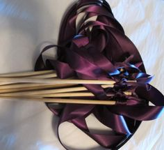 Tie the Knot - Satin Wedding Ribbon Wands - Custom Colors - Pack of 50 - Shown in Plum. $48.25, via Etsy.