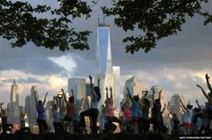 People stretch as they take part in a yoga class across the Hudson River