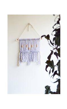 Macrame wall hanging with light purple / lilac wool yarn and
