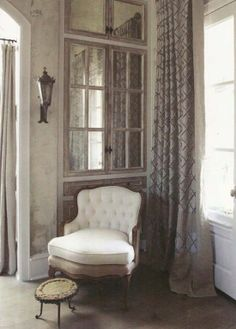 Built-in cabinets using antique doors.. Totally French!