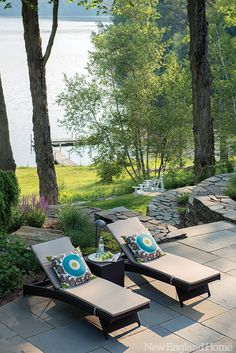 Simple chaises encourage relaxing on the patio that bridges house and water. Photo by John Gruen