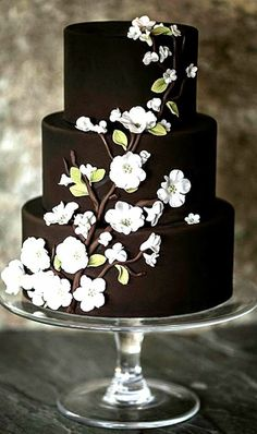 A Chocolate Wedding Cake With White Flowers. Rich, chocolaty browns conjure up the best of winter. Ana Parzych Cakes whipped up a cake in the shade that featured wedding-worthy white flowers. See more brown wedding cakes. Beautiful Wedding Cakes, Gorgeous Cakes, Pretty Cakes, Amazing Cakes, Brown Wedding Cakes, Black And White Wedding Cake, Chocolate Wedding Cakes, Chocolate Cake, Chocolate Brown