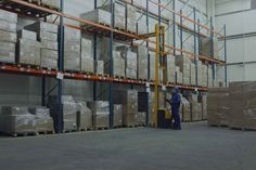 Worker counting stocks in warehouse. Worker in blue uniform counting stocks in w , Moving And Storage, City Illustration, Heavy Equipment, Street View, Stock Photos, Warehouse Worker, Image, Third Party, Everything