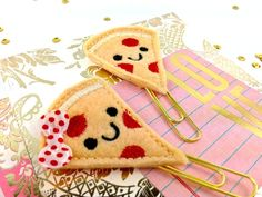 Pizza Face Planner Paper Clip Set of 2 | Felt Paper Clips Book markers | Planner Addicts. Hungry for Pizza? No more! With these super cute Pizza Face Paper Clip Planners you are guaranteed to satisfy that hunger. These are so much fun and look great peeking also as photo or card holders.  The perfect accessory for your Filofax, KikkiK, Midori or Erin Condren Planner #planneraddicts #plannerpaperclips #paperclips #noveltypaperclips #feltpaperclips #pizzaface #pizzapaperclip