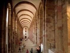 OTTONIAN ARCHITECTURE - Side aisles, the cathedral of Speyer, Germany, begun 1030. It is the one of the earliest stone vaulting dome in Germany. In order to support the heavy stone vaulting, interior divided into a tripartite space by side aisles as the structural buttresses for the vault. The vaulting is completed around 1137.