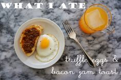 hearty breakfast - eggs, sunnyside up with a sprinkle of truffle salt and fresh baked bread slathered with spicy bacon jam