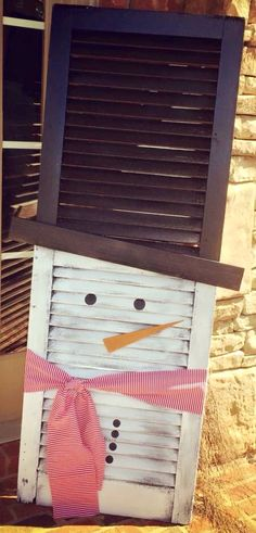repurpose an old shutter for an easy Christmas holiday decoration: paint, scrap of fabric, and some colored paper