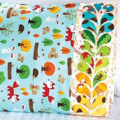 Robert Kaufman Fabrics Fabric Used: Forest Playground by Feng Liang Download the free feather applique pattern here: http://www.allpeoplequilt.com/millionpillowcases/freepatterns/Pillowcase-37.pdf