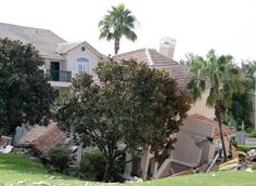(That's so bizarre that it is hard to believe.  But it's true.) A portion of a building rests in a sinkhole Monday, Aug. 12, 2013 in Clermont, Fla. The sinkhole, 40 to 50 feet in diameter, opened up overnight and damaged three buildings at the Summer Bay Resort. (AP Photo/John Raoux)