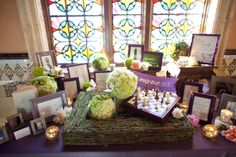 "This couple's desire to put ""poetry in motion"" was repeated in poems and quotes woven throughout their wedding décor. The soft purple and green hues harken back to the pastel palette of the Impressionist art that the bride enjoys. Photos: Tec Petaja Photography. Wedding Coordinator: Amorology Weddings. Florals: Adorations Botanical Artistry."