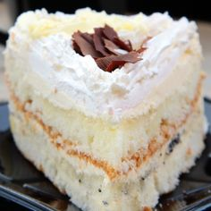 A light and fluffy white layered cakes recipe with creamy frosting and a chocolate garnish.. Fluffy White Layered Cakes Recipe from Grandmothers Kitchen.