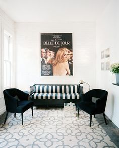 Living Room Midcentury Photo - A black-and-white settee and a pair of black armchairs in a bright living space