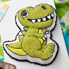 Dinosaur obsessed kids will be so excited when a T-Rex shows up at their birthday party when you use this Wilton dinosaur cake pan with complete decorating instructions included. Dinosaur Cake Pan, Dinosaur Cakes For Boys, Dinosaur Cupcakes, 3d Birthday Cake, Dinosaur Birthday Cakes, Birthday Parties, Dinosaur Party, Dinosaur Baby Showers, Third Birthday